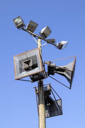 old loudspeakers against blue sky