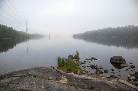 foggy lake scene, Lappeenranta Finland Imagens