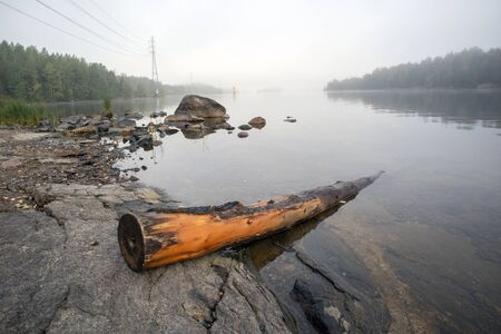 foggy lake scene, Lappeenranta Finland Imagens - 131843754