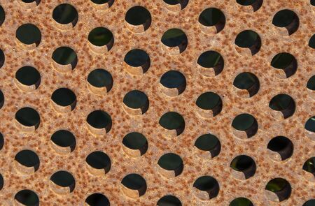 rusty metal plates with holes Imagens