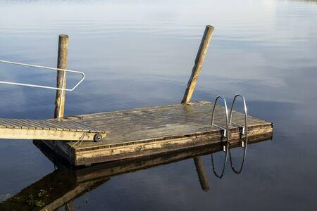 Wooden jetty on lake Saimaa, Lappeenranta Finland Imagens