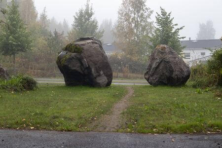 Boulders as traffic obstacles at the end of the street
