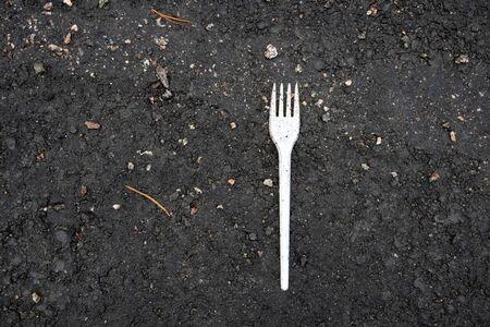 white plastic fork on ground Imagens