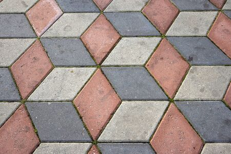 Ground tiles forms decorative pattern pavement