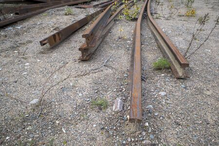 dismantled railroad rails on ground outdoors Imagens - 131801369