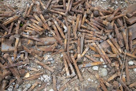rusty railroad spikes on ground outdoors Imagens - 131843824