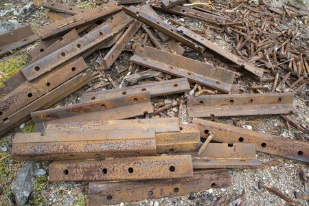 rusty railroad spikes and parts on ground outdoors Stock fotó