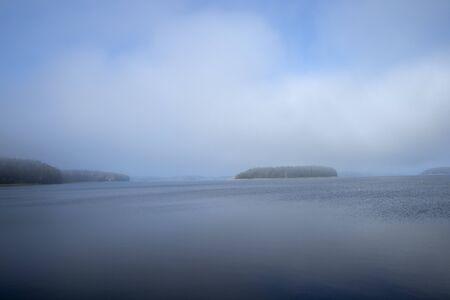 Foggy lake Saimaa scenery, Lappeenranta Finland Imagens