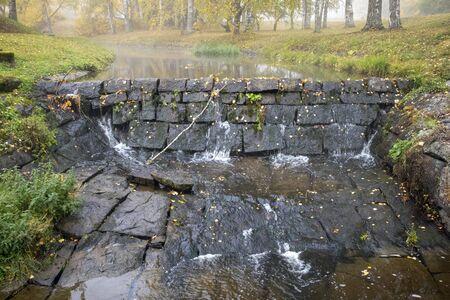 water leaking through stone dam construction in Mustola Lappeenranta Finland Imagens
