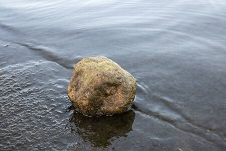 Small stone on a rocky shore, Finland Imagens - 132673510