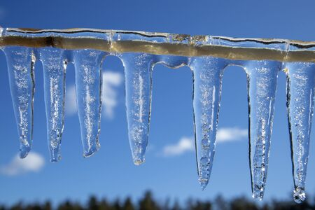 clear icicles against blue sky