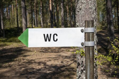 wc toilet sign in forest