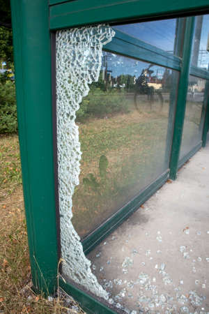 broken glass at a train station platform shelter