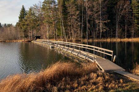 Wooden bridge pathway over water surface in Mellonlahti, Imatra Finland