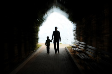darkness: tunnel, a young, hand in hand together, speed,