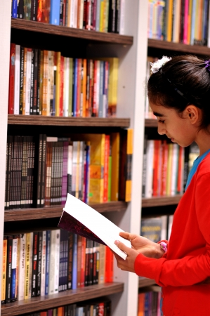 book shop: Book reading, library, girl, bookshelf Stock Photo
