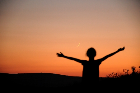 siluet: people have opened their arms at sunset Stock Photo