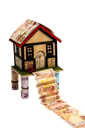 Little house and turkish money isolated over white  photo