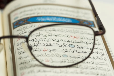reading glasses: Holy Quran and glasses macro Stock Photo