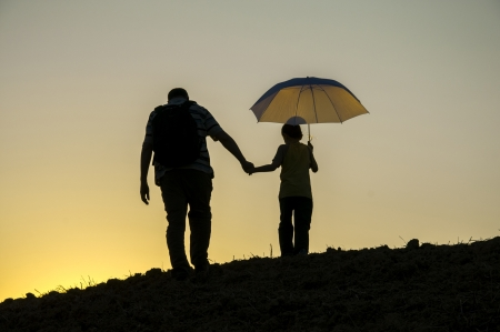 father and son reached the summit sunset Stock Photo