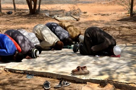 muslim prayer: African Muslims praying in the open area