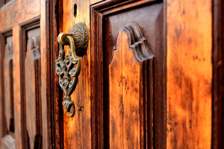 wooden old door and antique door knocker Stock Photo - 17092493