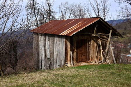abandoned wooden hut in rural areas photo