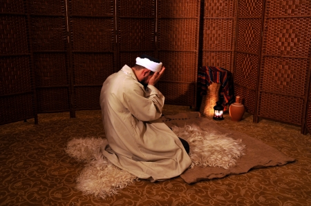Muslim man praying in a spiritual atmosphere photo