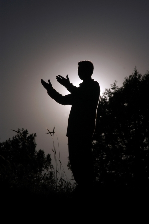 praying man silhouette standing