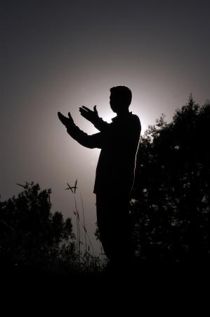 islamic pray: praying man silhouette standing