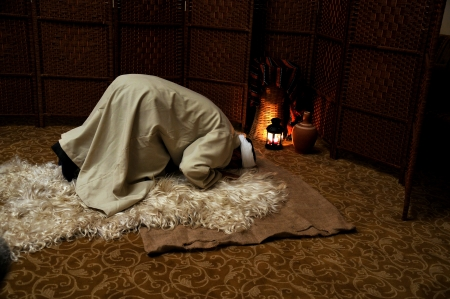 Muslim man praying alone, in prostration Stock Photo