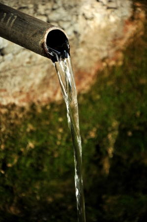 iron pipe flowing clean drinking water photo