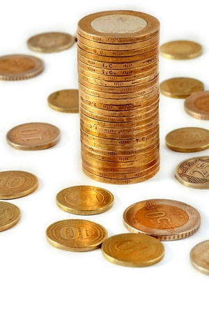 power of money: stacks of Turkish coins on white background Stock Photo