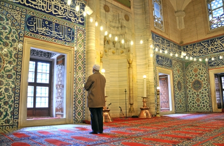 Muslim prayers in the mosque alone Stock Photo - 21007592