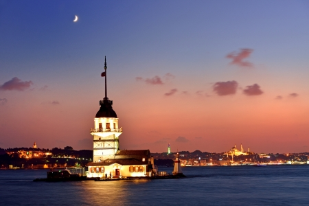 turkey beach: Maiden s Tower view at night with crescent  Istanbul Turkey