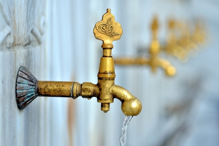 Antique Turkish faucet on wall