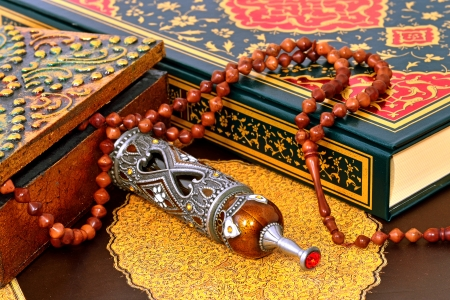 god box: prayer and pilgrimage perfumel on the Holy Quran Stock Photo