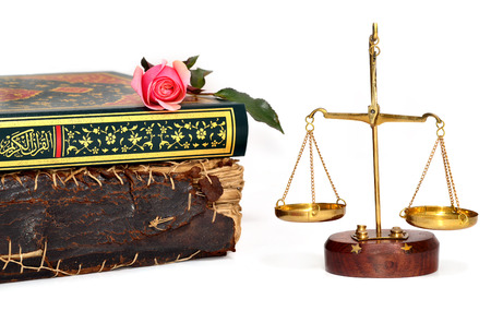 investigate: old book, holy quran on rose and justice scales