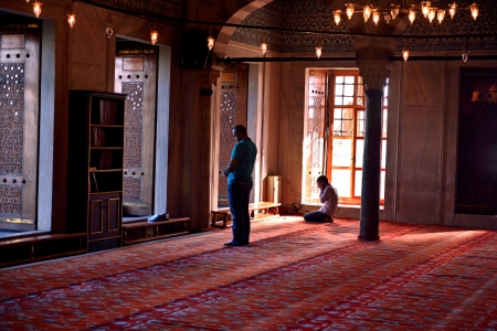 Fatih, Istanbul, Turkey - October 6, 2013   Muslims praying in the Blue Mosque Istanbul