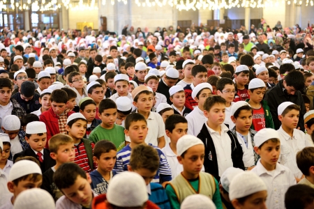 skullcap: ISTANBUL, TURKEY - OCTOBER 6  Fatih Mosque to pray for the kids on October 6, 2013 in Istanbul  Held in Istanbul Fatih Mosque  I turned to prayer, I begin 7  is about 7 thousand children participated in the program  Editorial