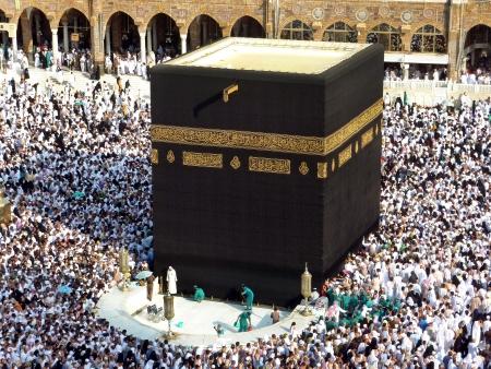 minarets: MECCA, SAUDI ARABIA - AUGUST 29  Muslim pilgrims, from all around the World, are circumambulating the Kaaba on August 29, 2010 in Mecca, Saudi Arabia