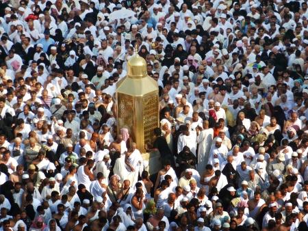 erecting: MECCA, SAUDI ARABIA - AUGUST 29  Muslim pilgrims, from all around the World, are circumambulating the Kaaba on August 29, 2010 in Mecca, Saudi Arabia