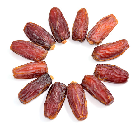 palm fruits: dry date palm fruits lined circular