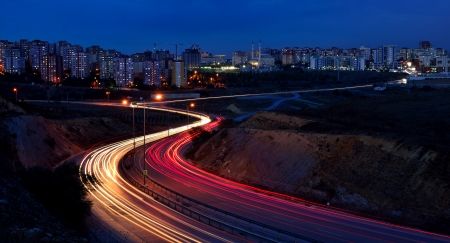 cornering: At night, the cars on the highway