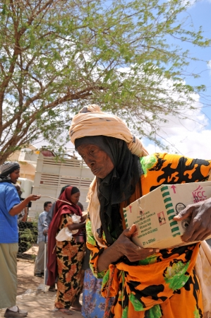 DADAAB, SOMALIA - AUGUST 7  Remaining in the Dadaab refugee camp receives african aged woman going home with assistance  Hundreds of thousands of immigrants are staying in refugee camps  August 7, 2011 in Dadaab, Somalia