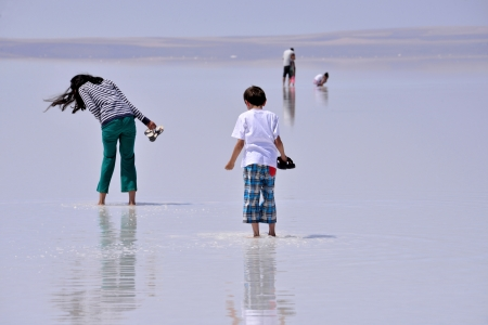 SALT LAKE, TURKEY - JULY 03  People walking at Salt Lake on July 03, 2013 in Aksaray, Turkey  Salt Lake is the second largest lake in Turkey