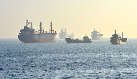 sea cargo ship and oil tanker in the fog