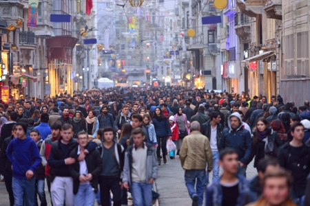 ISTANBUL, TURKEY - JANUARY 12  People walking on Istiklal Street on January 12, 2014 in Istanbul, Turkey  It is the most famous street in Istanbul, visited by nearly 3 million people in a single weekends day Editorial