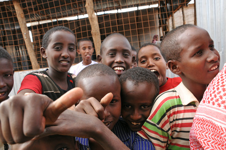 somalian: DADAAB, SOMALIA-AUGUST 07  Children stretch out their hands at the Dadaab refugee camp where thousands of Somalian wait for help because of hunger on August 07, 2011, in Dadaab, Somalia