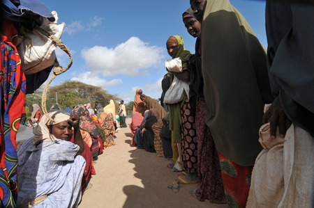 DADAAB, SOMALIA - AUGUST 7 Unidentified women and men live in the Dadaab refugee camp hundreds of thousands of Somalis wait for help because of hunger on August 7, 2011 in Dadaab, Somalia Editorial